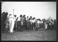 Boys preparing to run a three-legged race, (Labor Day?), Brooklyn or Queens, undated (ca. September 1917).