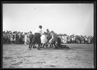 Boys in a scrum over shoes, (Labor Day?), Brooklyn or Queens, undated (ca. September 1917).