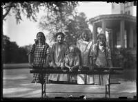 William Gray Hassler and four unidentified girls posing on a park bench, Isham Park, Inwood, New York City, undated (ca. 1913-1914).