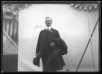 Unidentified man in a suit standing in front of a tent, New York City, undated [ca. November 1918].