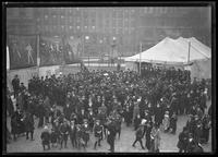 Crowd gathered around a brass band, New York City, undated [ca. November 1918].