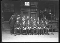 Group of streetcar conductors [?] seated at 32nd Street, New York City, undated [ca. April 1919].
