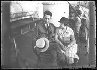 Unidentified man and woman seated on the deck of a ship, undated [ca. August 1919]. Photographed for (?) Charles Saus, Chelsea Avenue.