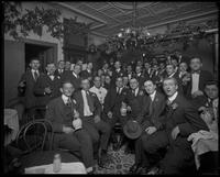 Unidentified group of men celebrating with wine, New York City, September 28, 1916.
