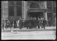 Group of unidentified men gathered outside a hotel or apartment building, New York City, undated (ca. 1915).