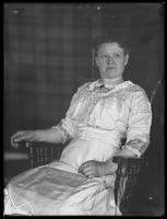 Belle Hassler Welty in rocking chair, undated (ca. 1914-1921).