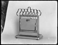 Product shot of an electric toaster, probably January 9, 1919. Photographed for the United Electric Light & Power Company.