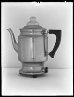 Product shot of an electric coffee percolator, probably January 9, 1919. Photographed for the United Electric Light & Power Company.