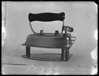 Product shot of an electric iron, probably January 9, 1919. Photographed for the United Electric Light & Power Company.