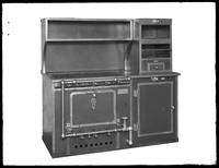 Product shot of a Walter J. Buzzini Inc. combination stove and oven, undated (ca. 1914-1921). Background matted out.