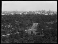 High angle view of Central Park from the west side, looking southeast, New York City, undated (ca. 1914-1916). Queensboro Bridge visible.