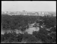 High angle view of Central Park from the west side, looking east at the Lake, Bow Bridge and the Boathouse, New York City, undated (ca. 1914-1916).