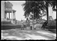 William Gray Hassler and four unidentified girls, seen from behind, Isham Park, Inwood, New York City, undated (ca. 1913-1914).
