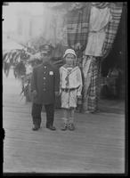 William Gray Hassler posing with an unidentified man in a police costume, undated (ca. 1913-1914).