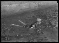 William Gray Hassler swimming in a concrete pool, undated (ca. 1913-1914).