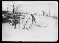 William Gray Hassler in the snow dragging a sled through an unidentified park, undated (ca. 1913-1914).
