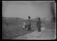 Two women and a boy walking through an unidentified field, undated (ca. 1913-1914). Possibly William Gray Hassler and Ethel Magaw Hassler.