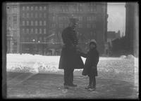 William Gray Hassler shaking hands with a police officer, winter, New York City, undated (ca. 1913-1914).