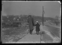 William Gray Hassler walking with an unidentified man and dog, winter, New York City (?), undated (ca. 1913-1914).
