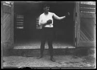 English boxer William Thomas Wells' (Bombardier Billy Wells) sparring partner, 'Syd,' undated (ca. 1910).