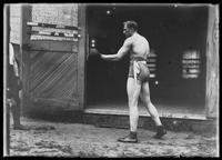 English boxer William Thomas Wells (Bombardier Billy Wells), posing in boxing togs, undated (ca. 1910).