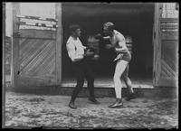 English boxer William Thomas Wells (Bombardier Billy Wells) and 'Syd' spar, undated (ca. 1910).
