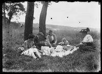 Ethel Magaw Hassler, William Gray Hassler, Belle Hassler Welty, and James and Walter Welty having a picnic, undated (ca. 1913-1914). Emulsion damge.