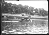 Small pleasure boat, possibly on the Harlem River, undated (ca.. 1911-1921).