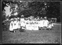 Group portrait of children from the Roman Catholic Orphan Asylum, Kingsbridge, Bronx, in white dresses, undated (ca. 1912).