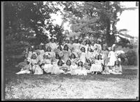 Group portrait of children from the Roman Catholic Orphan Asylum, Kingsbridge, Bronx, in white dresses holding fans, undated (ca. 1912).