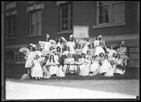 Group portrait of children from the Roman Catholic Orphan Asylum, Kingsbridge, Bronx, in fancy dress for 'Grandma Land,' undated (ca. 1912).