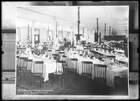 Copy photo of the refectory of the Roman Catholic Orphan Asylum, Kingsbridge, Bronx, tables set for dinner, Thanksgiving, 1910.