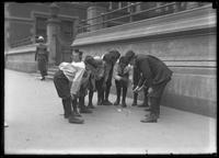 Boys playing dice on the sidewalk, probably the Lower East Side, New York City, undated (ca. 1915).