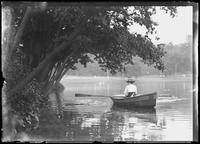 Ethel Magaw Hassler in a rowboat on an unidentified lake, undated (ca. 1915).