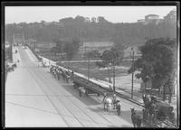 High angle view of Bronx-bound traffic approaching the University Heights Bridge, New York City, undated (ca. 1915). Hall of Fame for Great Americans visible in distance, right.