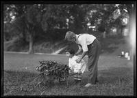 Clifford Moore (?) and William Gray Hassler with garden wheelbarrow, probably Inwood, New York City, September 7, 1915.