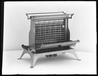 Product shot of an electric toaster, June 8, 1915. Photographed for the United Electric Light and Power Company.