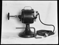 Product shot of an electric wire brush grinder, undated [ca. September 1915].