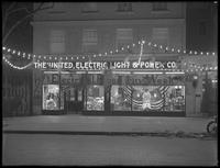 United Electric Light & Power Company storefront decorated for 'Electrical Prosperity Week' (November 29-December 4, 1915), New York City. Night view.