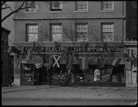 United Electric Light & Power Company storefront decorated for 'Electrical Prosperity Week' (November 29-December 4, 1915), New York City. Daytime view.
