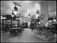 Interior showroom of the United Electric Light & Power Company shop, decorated for Christmas, New York City, undated, [December 1915].