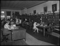 Children studying in an unidentified branch of the Queens Borough Public Library, February 24, 1916. Photographed for the Queens Borough Public Library.