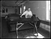 'Flowing' the wooden caskets in an air-tight room, Oneida, N.Y., April 3, 1916. Photographed for the National Casket Company (Oneida, N.Y.)