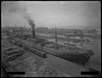 Unidentified ship [warship?] in dock, Brooklyn [?], undated [ca. May 1916].