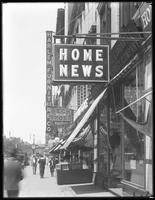 Home News sign, W. 125th Street, New York City, undated [ca. July 1916]. Photographed for Lawrence L. Strauss.