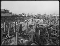 Unidentified construction site on Manhattan Beach, Brooklyn, December 1, 1916. Photographed for Joseph P. Day. Pilings driven into the sand.