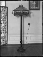 Floor lamp with fringed, tasseled shade, December 11, 1916. Photographed for the United Electric Light & Power Company.
