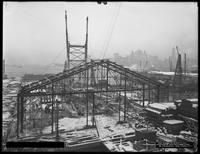 Steel structure being raised for a building on Pier 17, Joralemon Street, Brooklyn, December 1916. Photographed for the Robbins-Ripley Company.