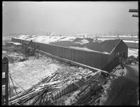 Pier 17, Joralemon Street, Brooklyn, February 8, 1917. Photographed for the Robbins-Ripley Company. Snow on the roof and frozen river.