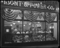 Storefront display of an unidentified United Electric Light & Power Company store, with red, white and blue bunting, New York City, undated (ca. November 1916).